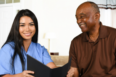 nurse who is working her shift taking care of senior man