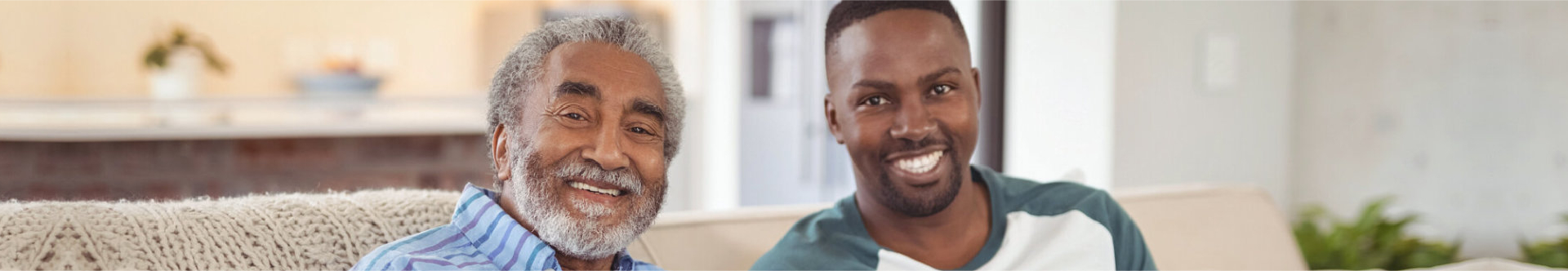 adult and senior man smiling